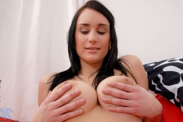 Anika grabs her sexy natural tits